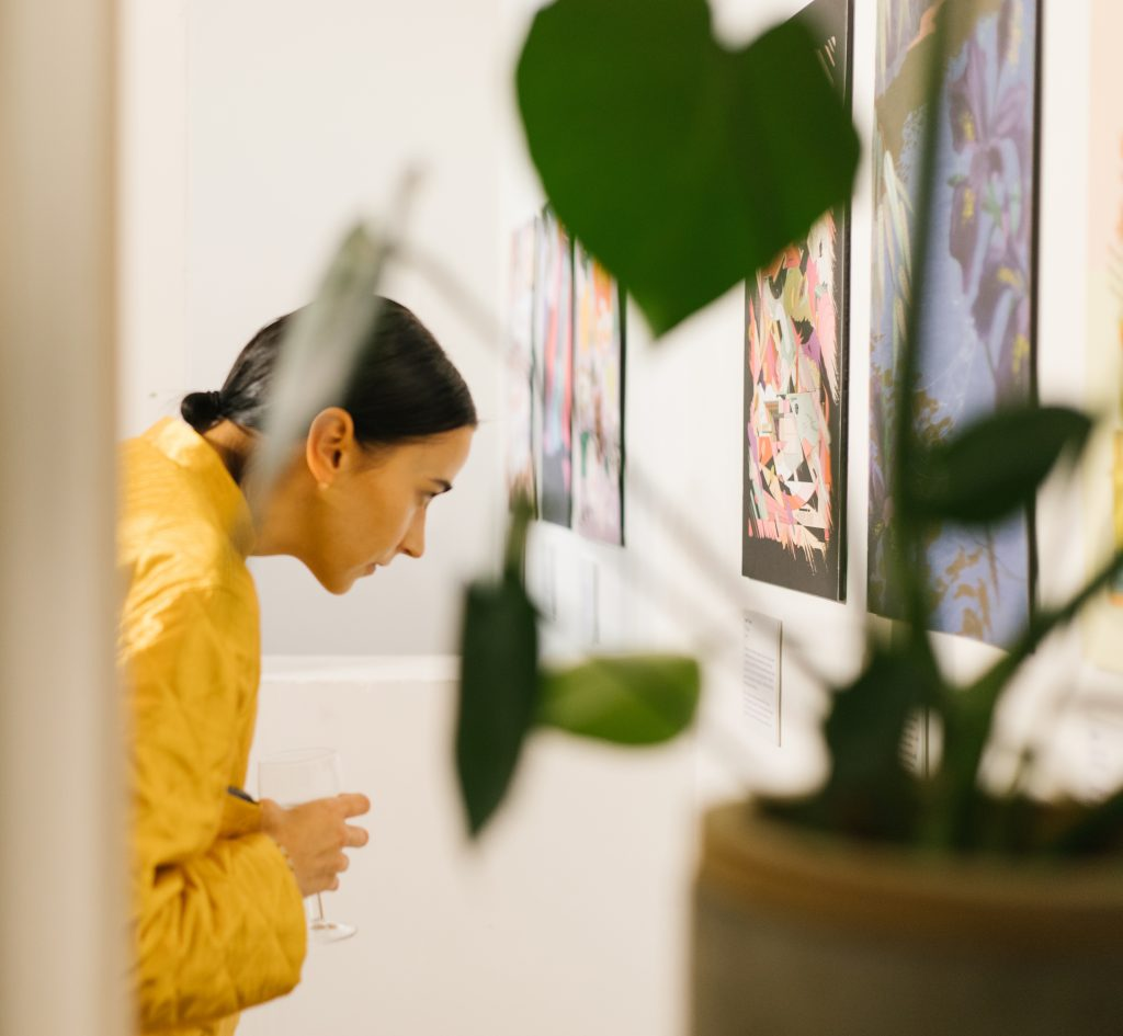 attendee looking at artwork – The World in Words campaign launches