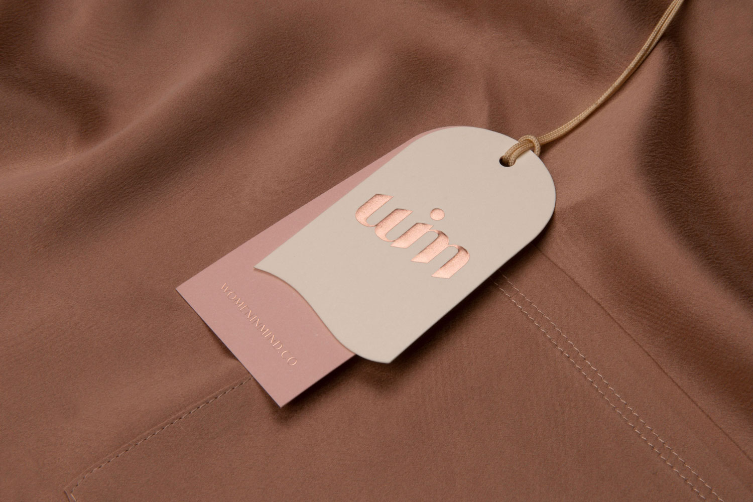 A WIM clothes tag on suede