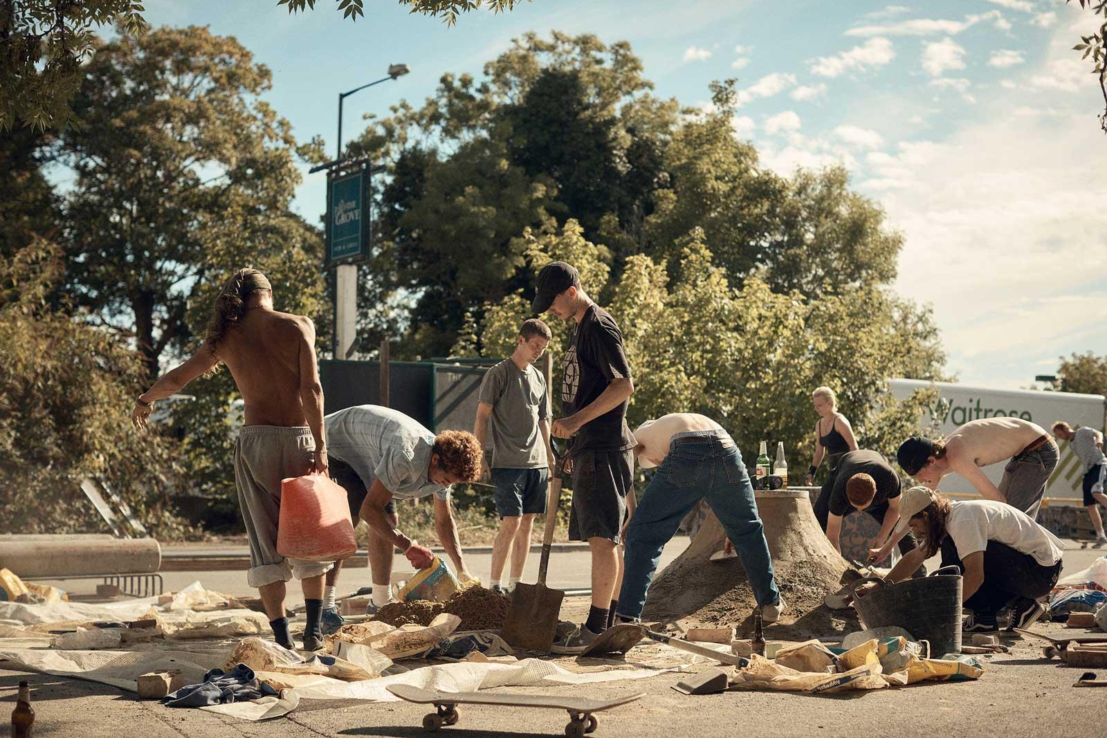 skaters constructing a skate park